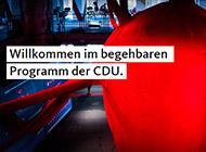 """Bild des fedidwgugl-Haus der CDU mit dem Slogan """"Willkommen im begehbaren Programm der CDU."""""""