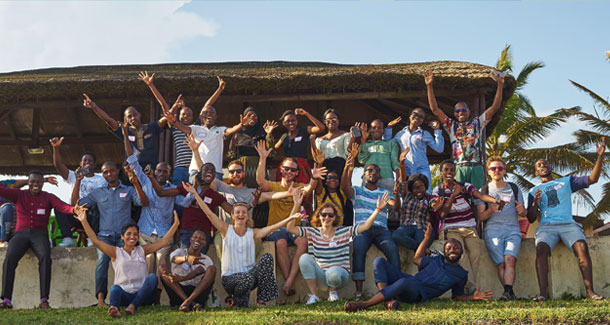 Group photo of Autumn School participants waving into the camera