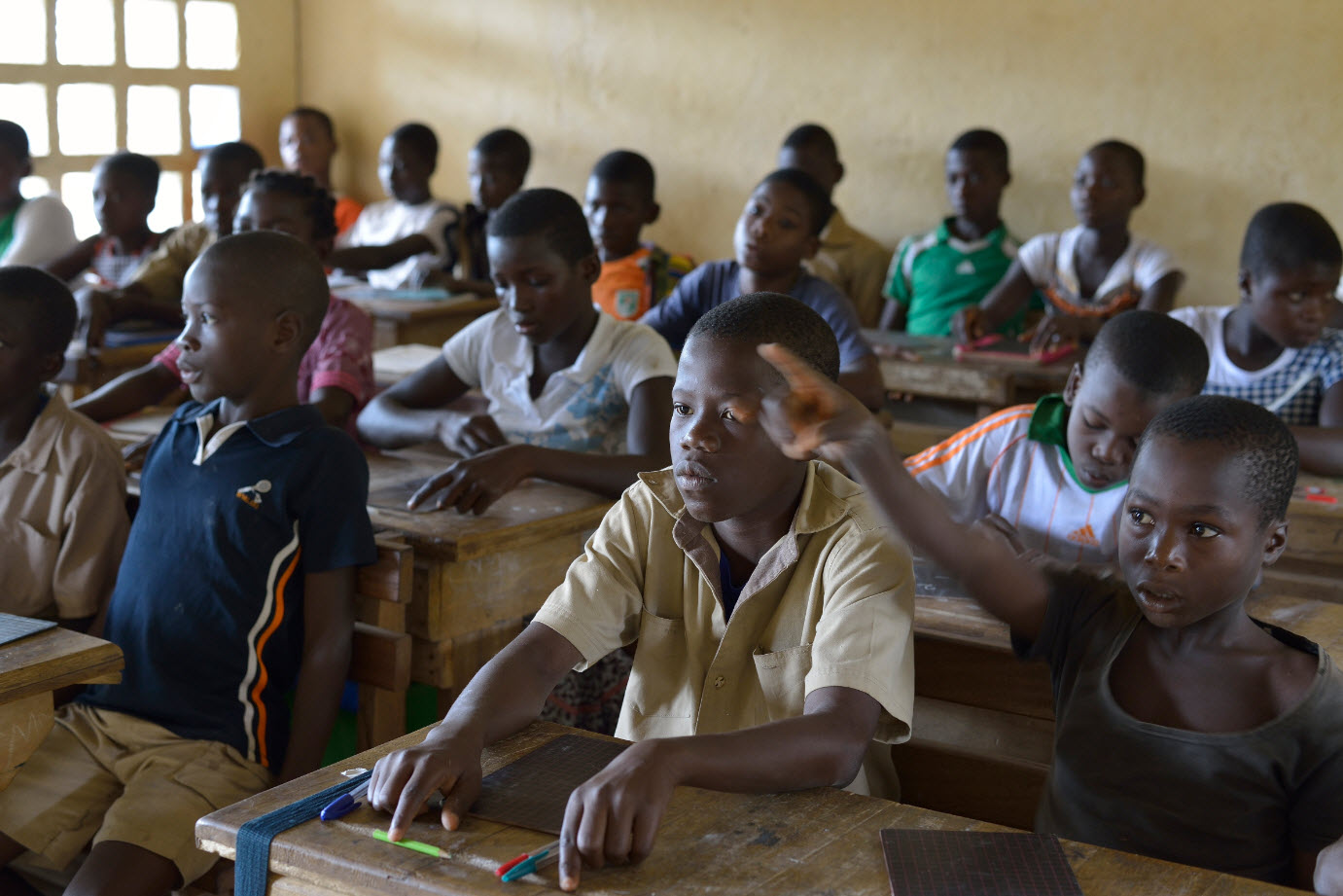 Schüler einer der aus der Fairtrade-Prämie finanzierten Schule der Kakao-Kooperative ECOOKIM aus der Elfenbeinküste  Fotograf: Nabil Zorkot