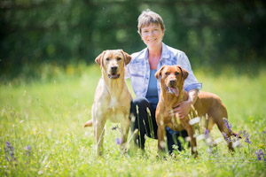 Picture by Christiane Slawik: Conservation dogs Kelo (left) and Karetta with trainer Marlene Zähner