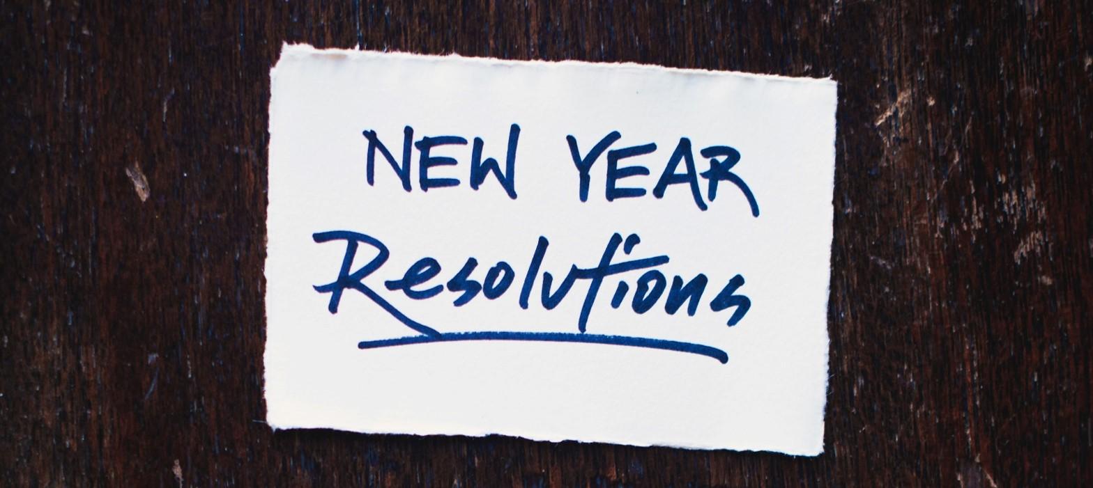 """Auf Papier steht """"New Year Resolutions"""""""