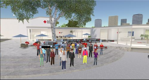 Gruppe von virtuellen Personen steht vor einem DRK-Gebäude. Ein Foto von einer Avatar-Digitalkonferenz
