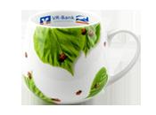 Fast runder Porzellanbecher mit Blättern und Marienkäfern