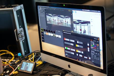 Ein Bildschirm zeigt das Set-up zur digitalen Fachtagung 2020.