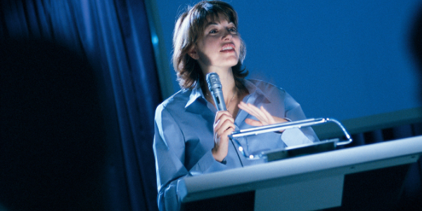 Woman at Podium, PhotoImages