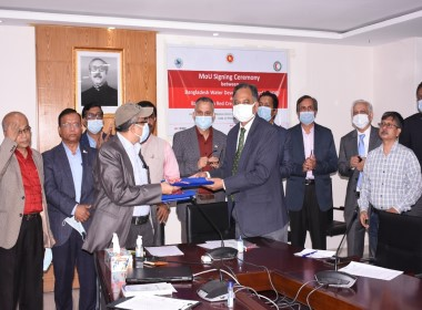 Image shows a group of men celebrating the signing of the MoU between FFWC and BDRCS