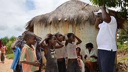 Children and teacher in African village
