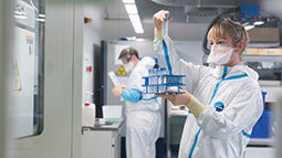 Two researchers working in TB laboratory