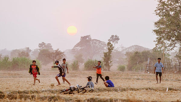 Children playing ball in Laos