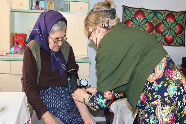 A woman has her blood pressure taken