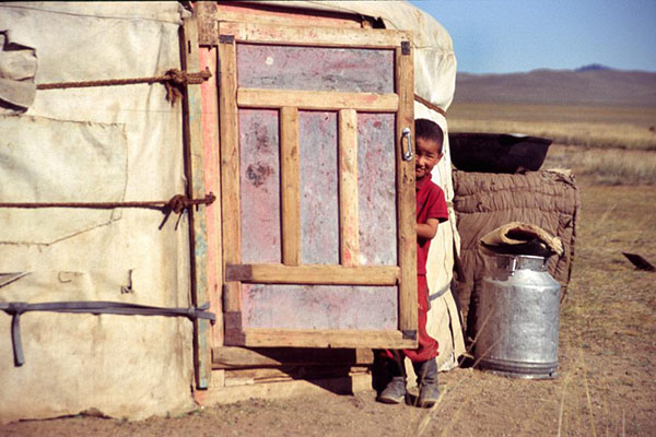 Child in front of a yurt in Mongolia