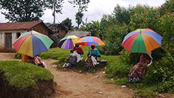 Women with umbrellas in Burundi