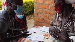 Research nurse and study participant in Rwanda