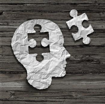 symbolischer Kopf mit Puzzelstück